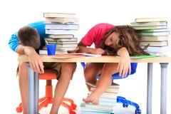 Kursteilnehmer ermüdet vom Studieren Stockbild