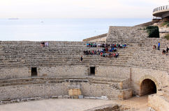 Kursteilnehmer im römischen Amphitheatre, Tarragona Lizenzfreies Stockfoto