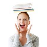 Kursteilnehmer mit Büchern auf ihrem Kopf Stockfoto