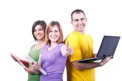 Kursteilnehmer mit Büchern und Laptop Stockfoto