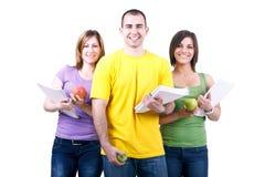 Kursteilnehmer mit Notizbüchern und Äpfeln Lizenzfreies Stockbild