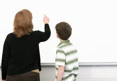 Kursteilnehmer und Lehrer Stockbild