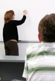 Kursteilnehmer und Lehrer Stockfotografie