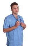 Kursteilnehmerdoktor scheuert innen sich und mit Stethoskop stockbilder