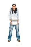 Kursteilnehmerfrauen-Holdingstapel Bücher Stockbilder