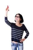 Kursteilnehmerfrauenschreiben etwas auf abstraktem Bildschirm Stockbild