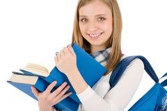 Kursteilnehmerjugendlichfrau mit Schultascheneinflußbüchern Stockfotos