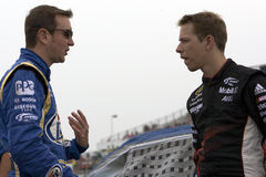 Kurt Busch talks with teammate Brad Keselowski Royalty Free Stock Images