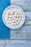 Kurt kurut - asian dried yogurt balls. On wood Stock Photography