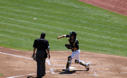 Kurt Suzuki throws from home during between inning Stock Images