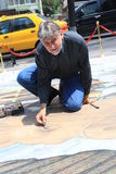 Kurt Wenner. Is a world-wide known street artist, who blends street painting with Renaissance classicism and creates unbelievable 3D paintings on pavements Stock Photography
