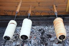 Kurtoskalacs – a traditional Hungarian food. Prepared on the grill stock images