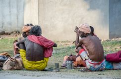 KURUKSHETRA, HARYANA, INDIA. 19 JUNE 2016 - Indian sadhus holy man sitting and chatting Royalty Free Stock Photos