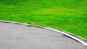Kurva av bakgrund för asfaltväg Arkivbilder