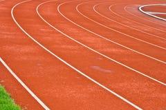 Kurve der Rennen-Spur im Stadion Stockfotografie