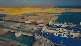 KURYK, KAZAKHSTAN - OCTOBER 16, 2018: Railway cars are waiting in the cargo ferry to transport my Caspian, in the port stock footage
