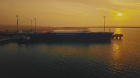 KURYK, KAZAKHSTAN - OCTOBER 16, 2018: Ship of ferry tanker in seaport on colorful background under yellow sunset stock video