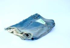 Kurze Jeanshose mit Euro 100 Stockfotos