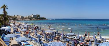 Kusadasi beach panorama. Panoramic view over the Ladies Beach, Kusadasi, Turkey. Ladies Beach, known in Turkish as Kadinlar Denizi, is one of the most popular Royalty Free Stock Photos