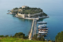 Kusadasi castle. Kusadasi, Turkey - April 7, 2014: View to the castle on Pigeon island. Built in Byzantine Era, now the castle houses the museum and is the Stock Image