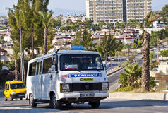 Kusadasi minibus - dolmus. Public minibus  called dolmus on the street of Kusadasi, Turkey. In Turkey dolmus are share taxis that run set routes within and Stock Images