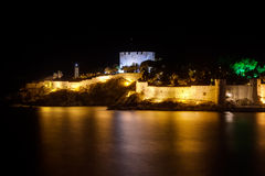 Kusadasi at night. A Fortress called Pigeon Island and lighthouse of the touristic west Aegean town Kusadasi in Turkey at night Stock Photography