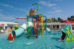 KUSADASI, TURKEY - AUGUST 21, 2017: Colourful plastic slides in aquapark. Children water playground stock photo