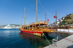 KUSADASI, TURKEY - MAY 23, 2015: Sightseeng tourist boats at Port of Kusadasi, Turkey.  stock photo