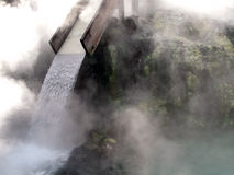 Kusatsu hot-spring, Japan. Hot-spring (onsen) comming out naturally from the ground in the center of the resort town of Kusatsu in Japanese Alps and passing Stock Photo