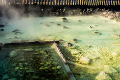 Kusatsu onsen yubatake. Kusatsu onsen - famous hot spring with yubatake - hot water spring in the center of the town Royalty Free Stock Photos