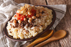 Kushari of rice, pasta, chickpeas and lentils close up. Horizont Stock Photo