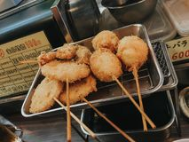 Kushikatsu, Japanese dish of deep fried skewered meat and vegetables royalty free stock image