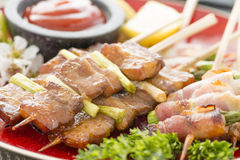 Kushiyaki. Butabara (belly pork) and Asuparabekon (asparagus wrapped in bacon). Japanese grilled food on skewers Royalty Free Stock Photo