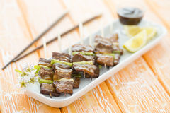 Kushiyaki. Butabara (belly pork) and Asuparabekon (asparagus wrapped in bacon). Japanese grilled food on skewers Royalty Free Stock Photos