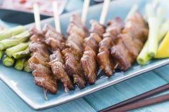 Kushiyaki. Butabara (belly pork). Japanese grilled food on skewers Stock Photo