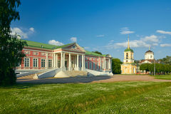 Kuskovo palace. The Palace of Kuskovo at foreground. Church of the Merciful Saviour in Kuskovo at background. The heritage of the Russian Federation 7710966000 Royalty Free Stock Image