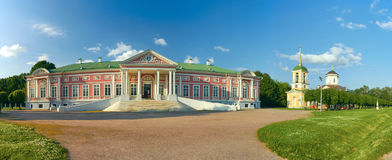 Kuskovo palace. The Palace of Kuskovo at foreground. Church of the Merciful Saviour in Kuskovo at background. The heritage of the Russian Federation 7710966000 Stock Photo