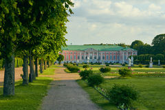 Kuskovo palace. Garden between the Orangerie and the Palace in Kuskovo Estate. The Palace of Kuskovo at background. The cultural heritage of the Russian Royalty Free Stock Photo