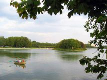 Kuskovo park in Moscow. People sail in a small boat. Royalty Free Stock Photography