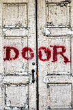 Kuslig gammal dörr Arkivbild
