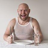 Kuslig och hungrig man fotografering för bildbyråer
