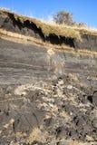 Kust- erosion på stranden av Burry port Royaltyfria Foton
