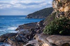 Kust- gångbana på den manliga stranden New South Wales Australien Arkivbild