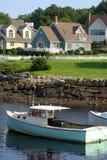 Kust huis en boot Royalty-vrije Stock Foto