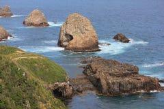 kust- sikt för klumppunktsolnedgång Arkivbilder