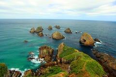 kust- sikt för klumppunktsolnedgång Fotografering för Bildbyråer