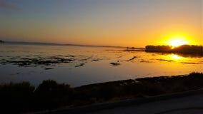 kust- solnedgång Arkivfoto