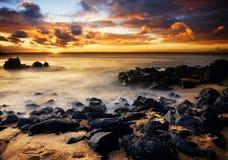 kust- solnedgång Arkivbilder