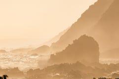 Kust- solnedgångplats för naturlig sepia Arkivfoto