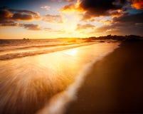 kust- soluppgång Arkivbild
